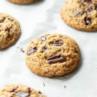 a close up of Low Carb Keto Chocolate Chip cookie on a baking sheet.