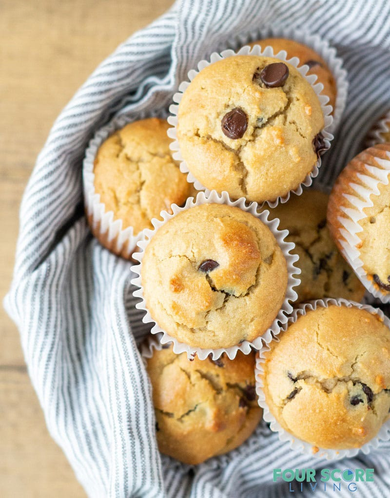 Low Carb Chocolate Chip Muffins in a bowl with a striped towel.