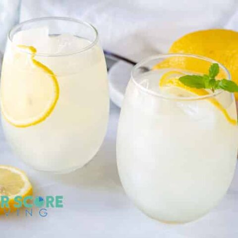 two glasses of keto lemonade with lemon and mint
