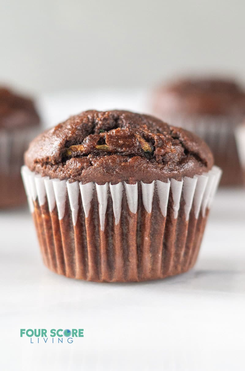 a chocolate muffin in a white cupcake liner