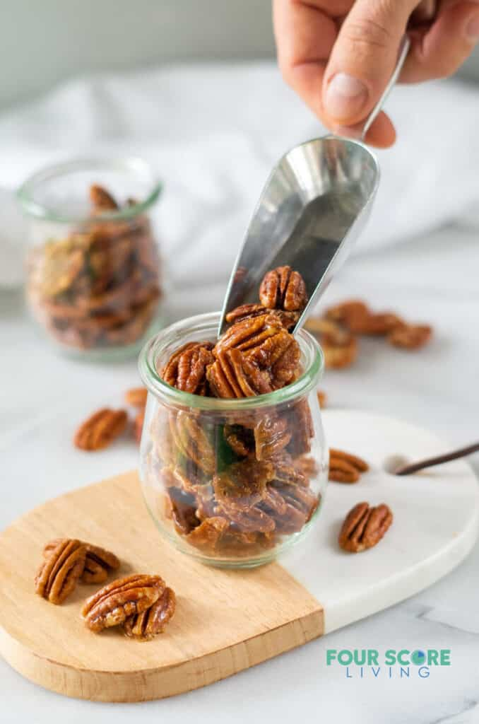 a scoop of keto candied pecans