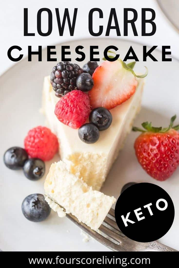 A slice of cheesecake topped with fresh berries on a plate. image includes a title, Low carb cheesecake, Keto.