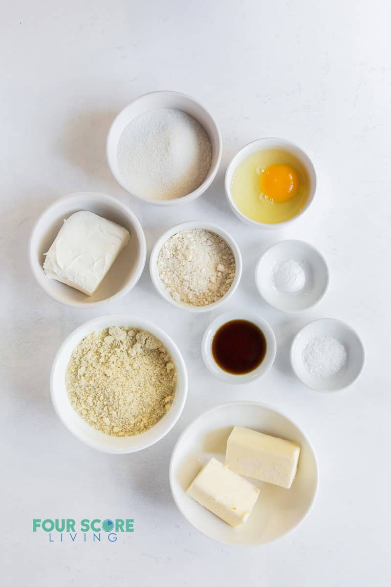 top down view of ingredients for cream cheese cookies in small bowls.