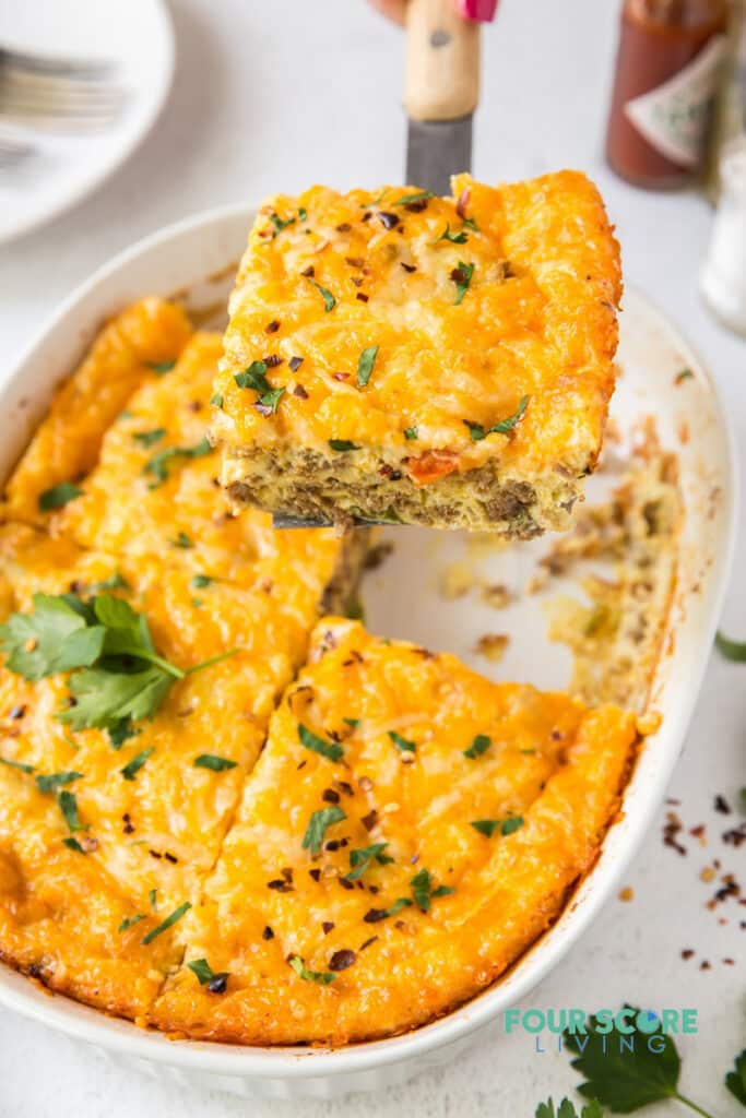 Keto breakfast casserole being served with a spatula.