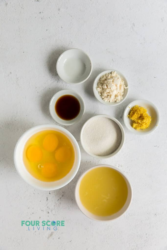 Top down view of ingredients needed for lemon bars in separate bowls.