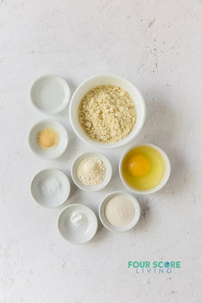 ingredients for keto tortillas in separate white bowls.