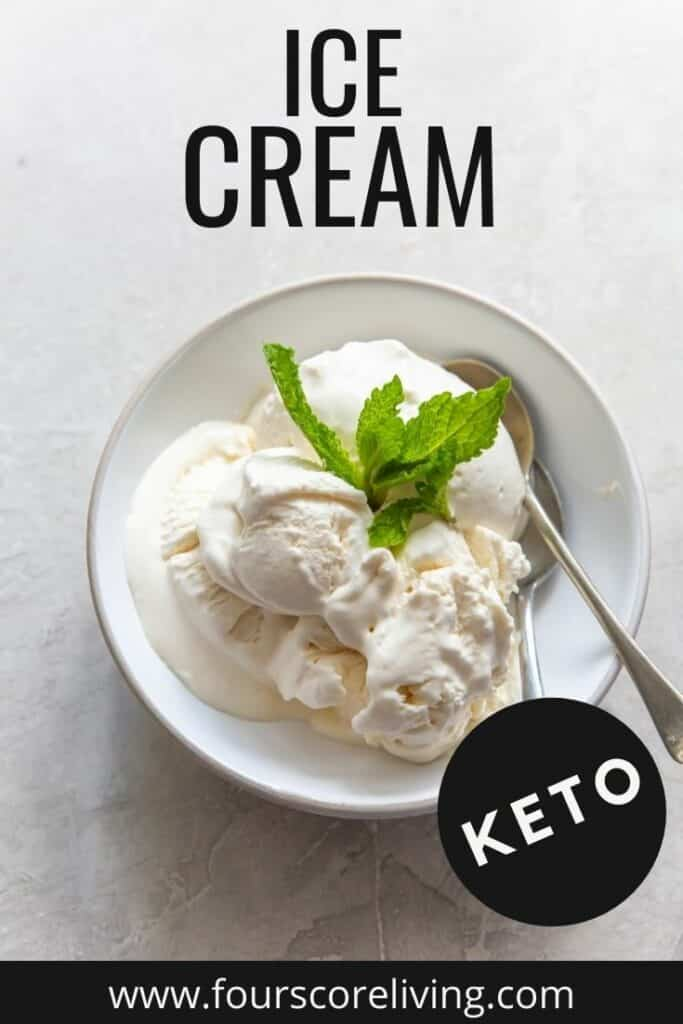 A white bowl of vanilla ice cream topped with fresh mint.