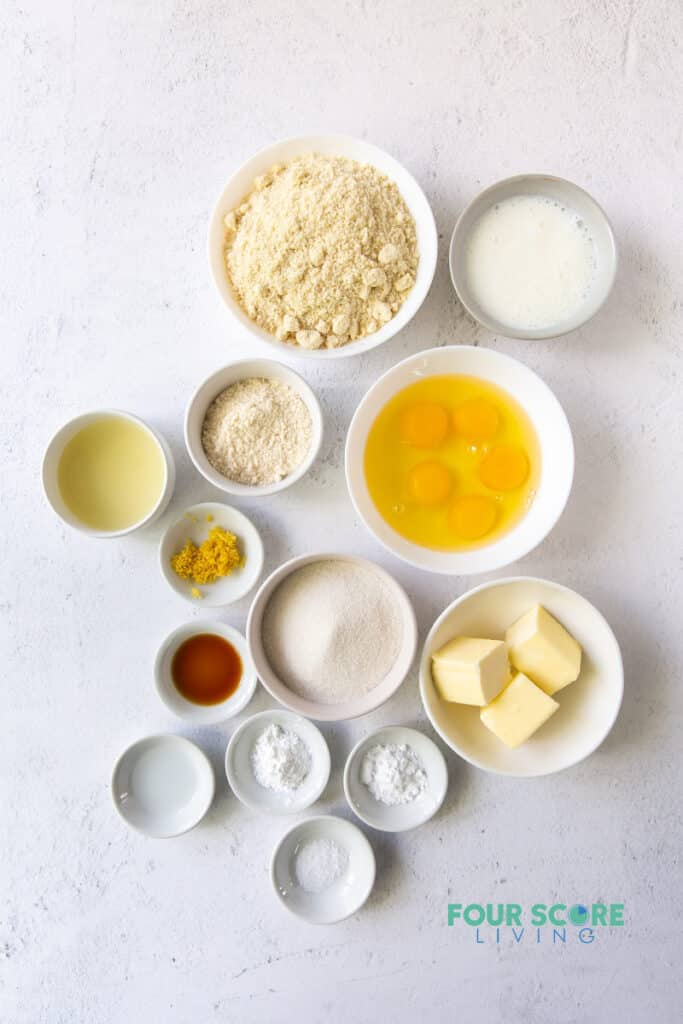 top down view of ingredients for keto lemon cake, including butter, eggs, flours, lemon zest, and others.