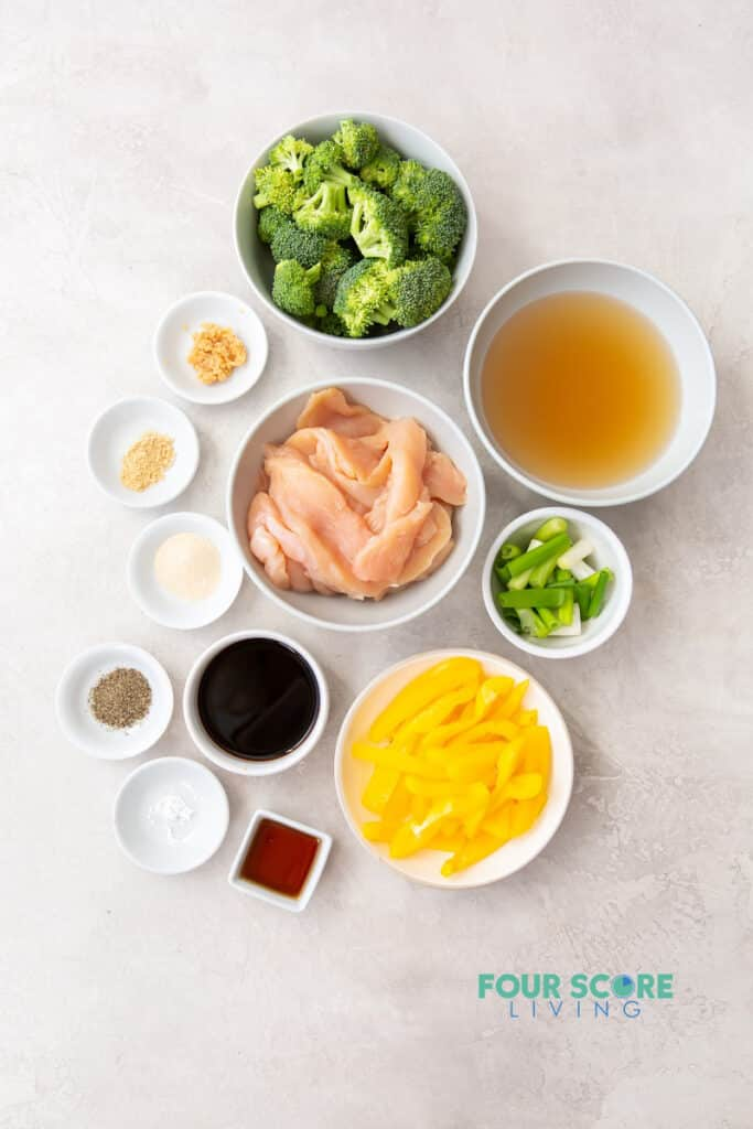 Ingredients for making keto stir fry, including chicken, broccoli, peppers, broth, and seasonings.