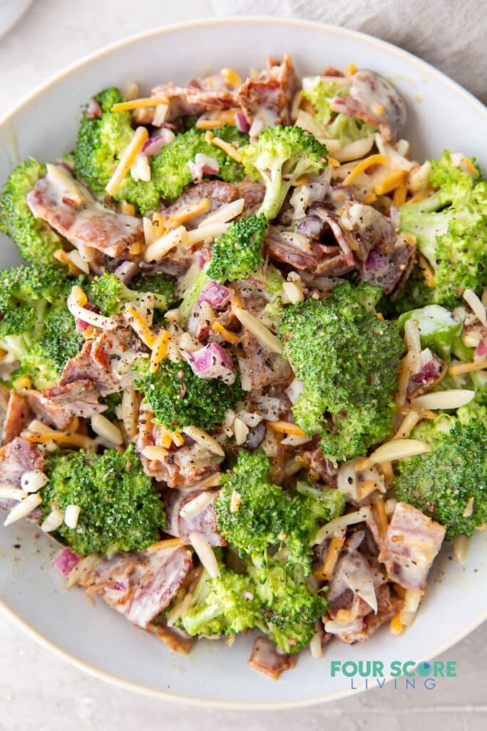 closeup view of keto broccoli salad in a bowl.